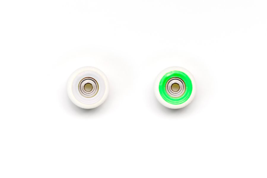 Dual Bearing White Wheels with White/Green Cores