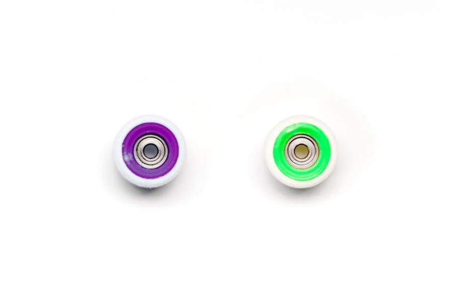 Dual Bearing White Wheels with Purple/Green Cores