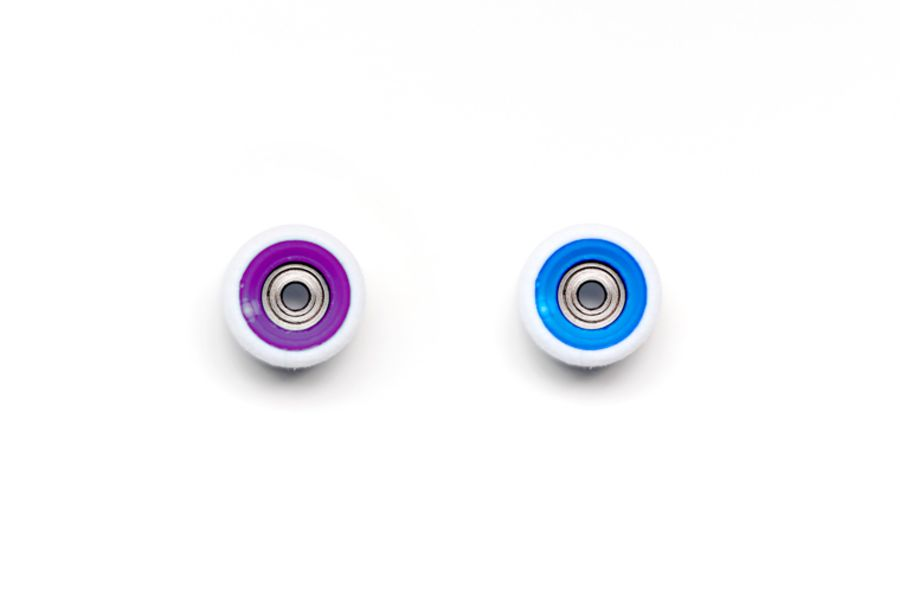 Dual Bearing White Wheels with Purple/Blue Cores