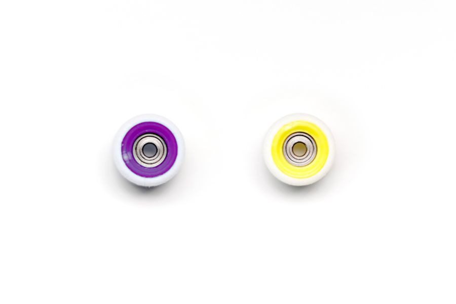 Dual Bearing White Wheels with Purple/Yellow Cores