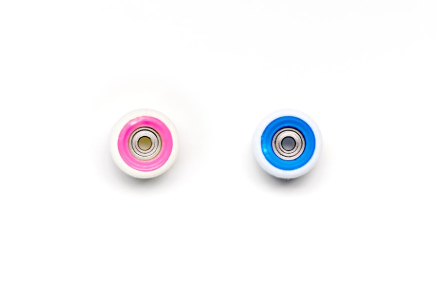 Dual Bearing White Wheels with Pink/Blue Cores