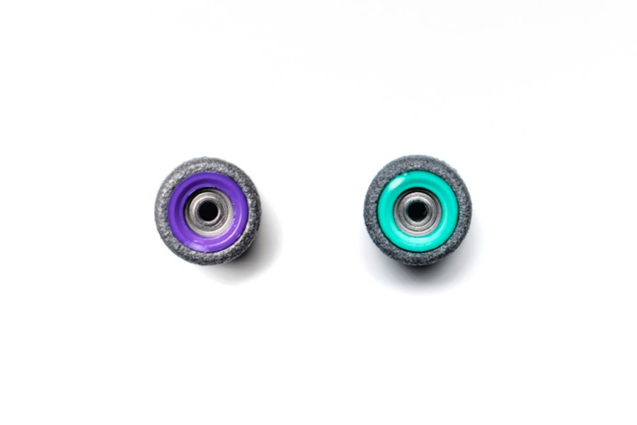 Dual Bearing Black Wheels With Purple/ Green Cores