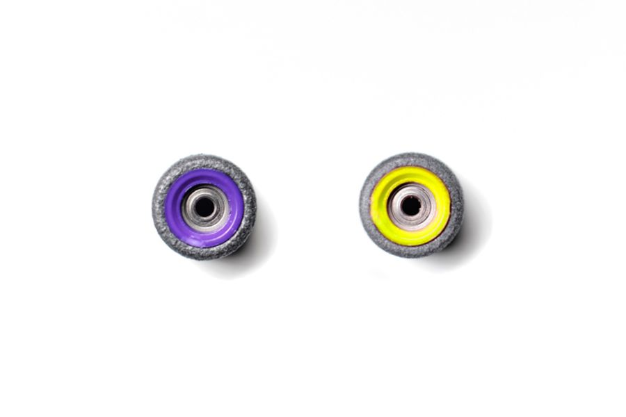 Dual Bearing Black Wheels With Purple/ Yellow Cores