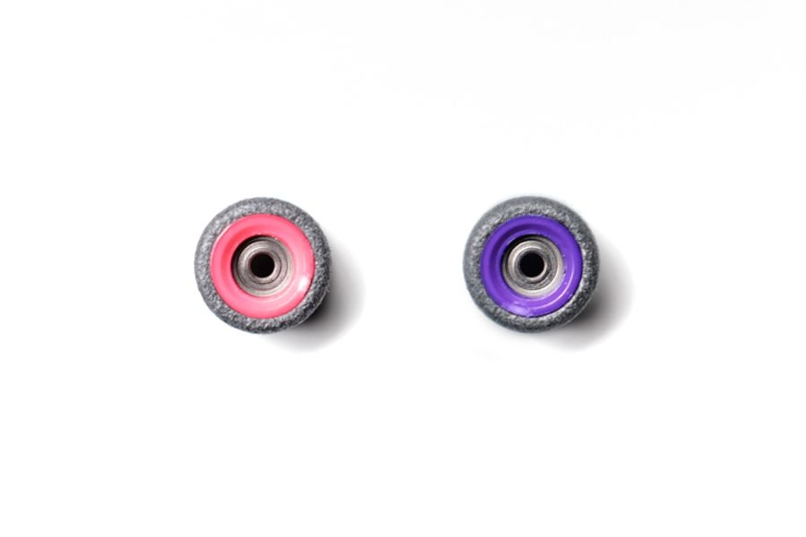 Dual Bearing Black Wheels With Pink/ Purple Cores