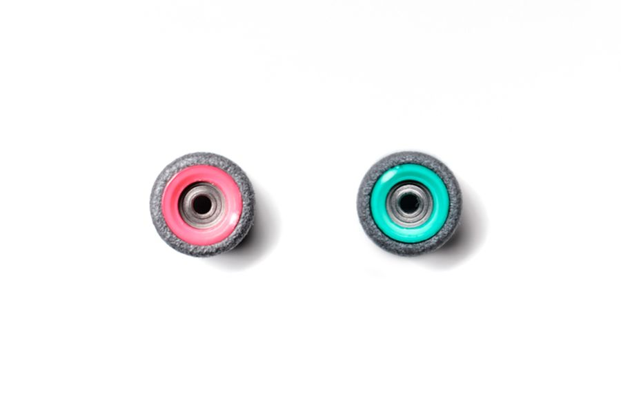 Dual Bearing Black Wheels With Pink/ Green Cores