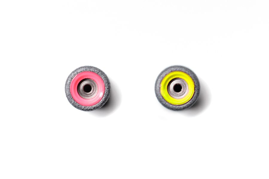 Dual Bearing Black Wheels With Pink/ Yellow Cores