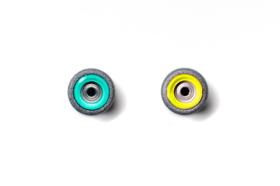 Dual Bearing Black Wheels With Green/ Yellow Cores