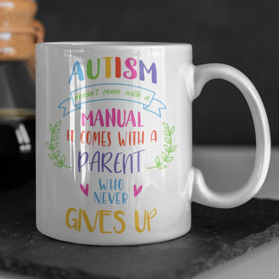 Autism doesn't come with a manual white 11oz mug
