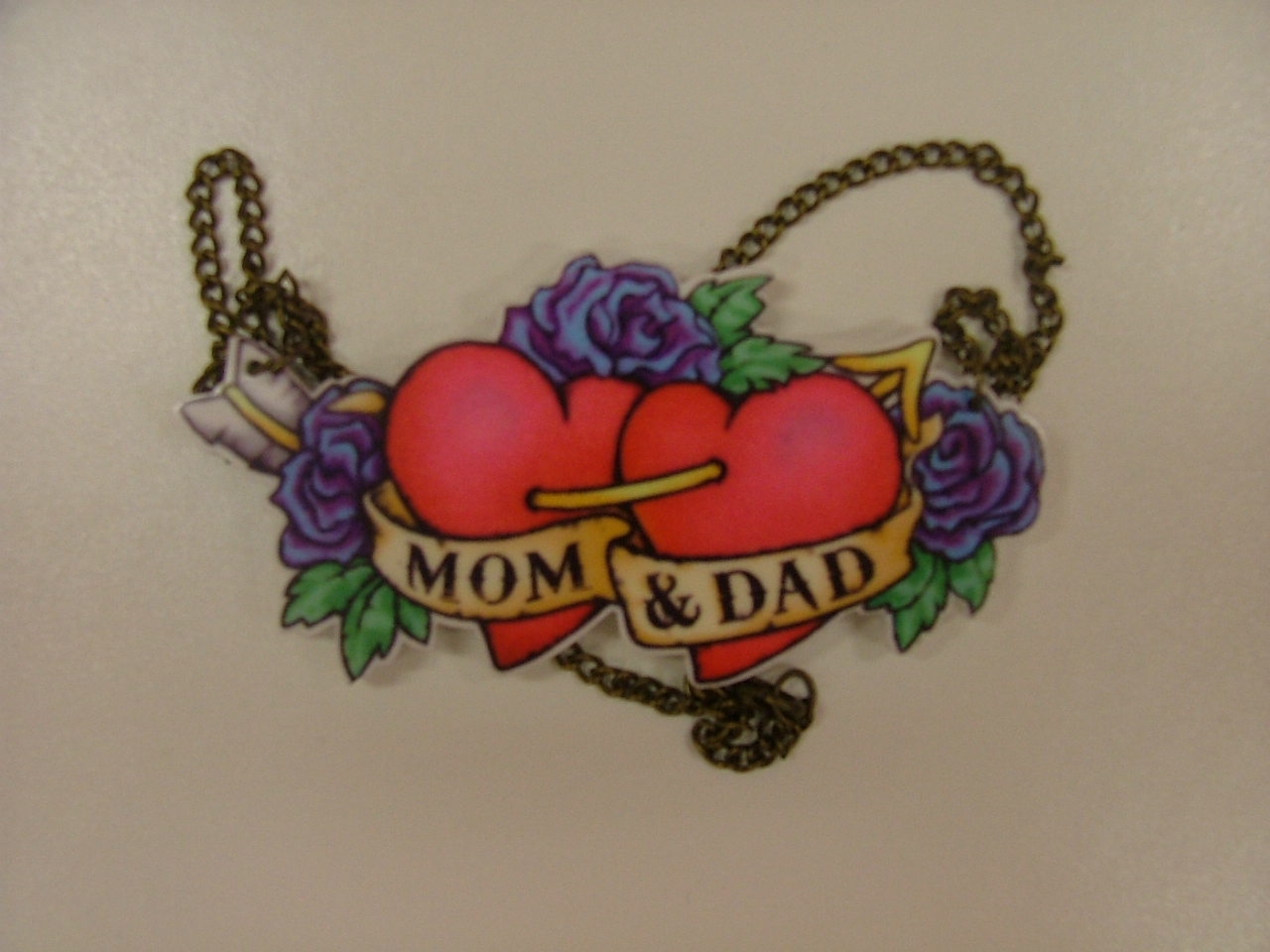 Bow and Crossbones Mom and Dad Heart Necklace