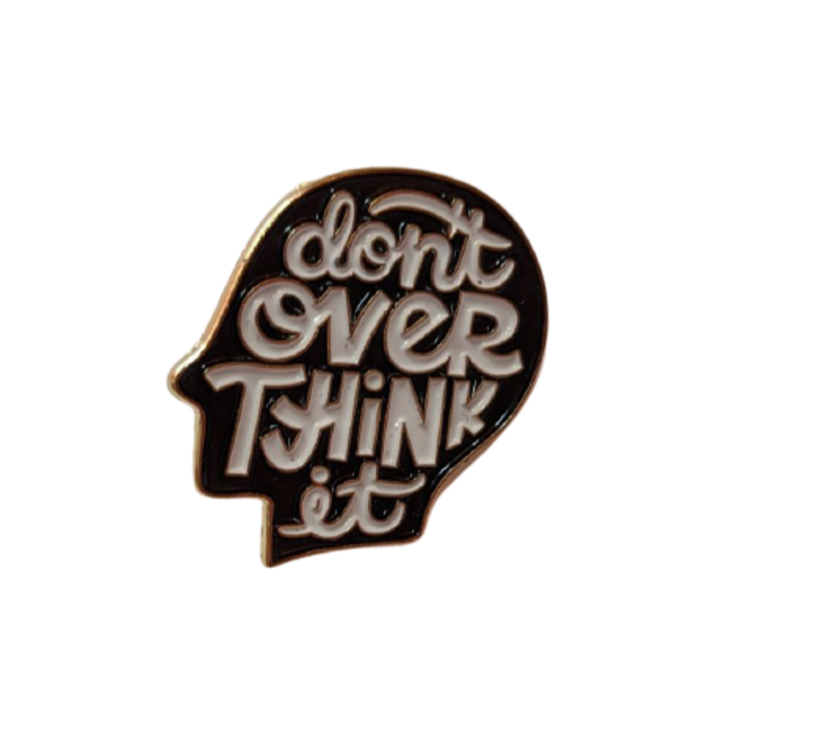 Totally on trend kitsch, 'Don't Over Think It' enamel pin badge
