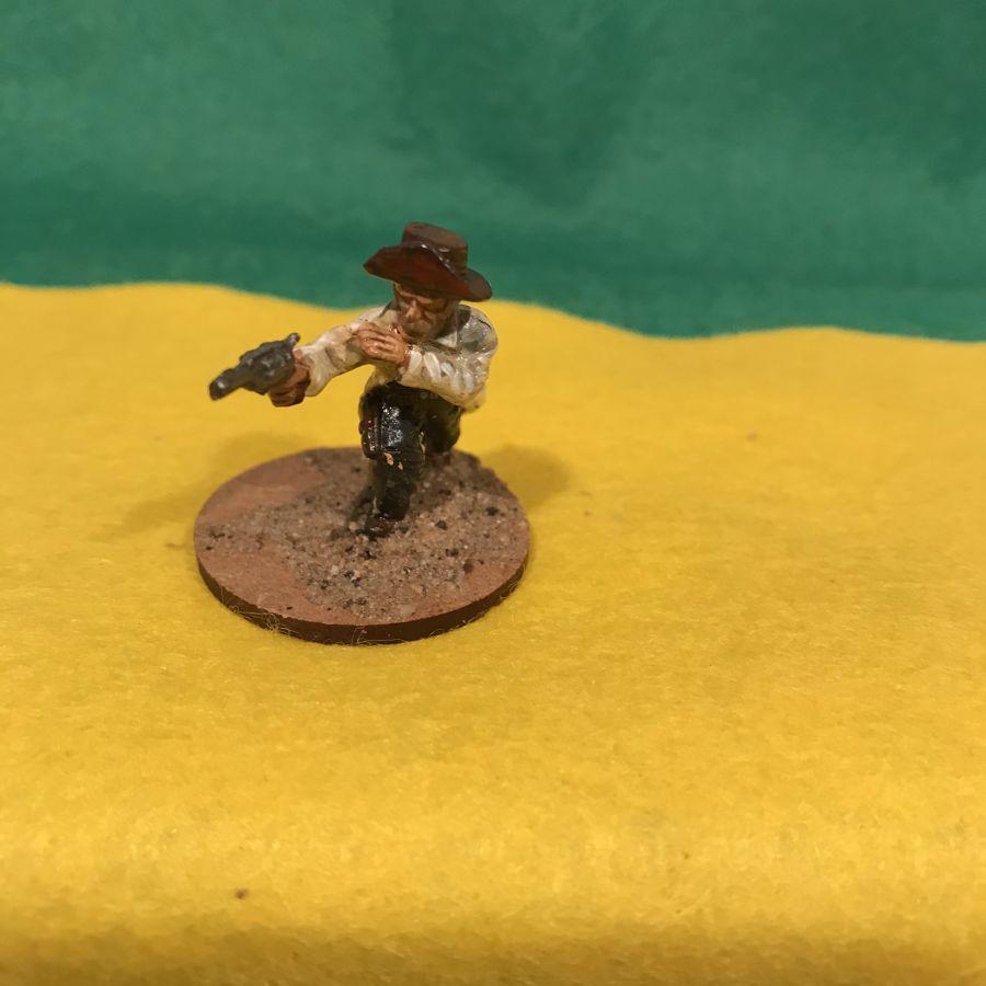 AW24 Cowboy in Duster firing pistol