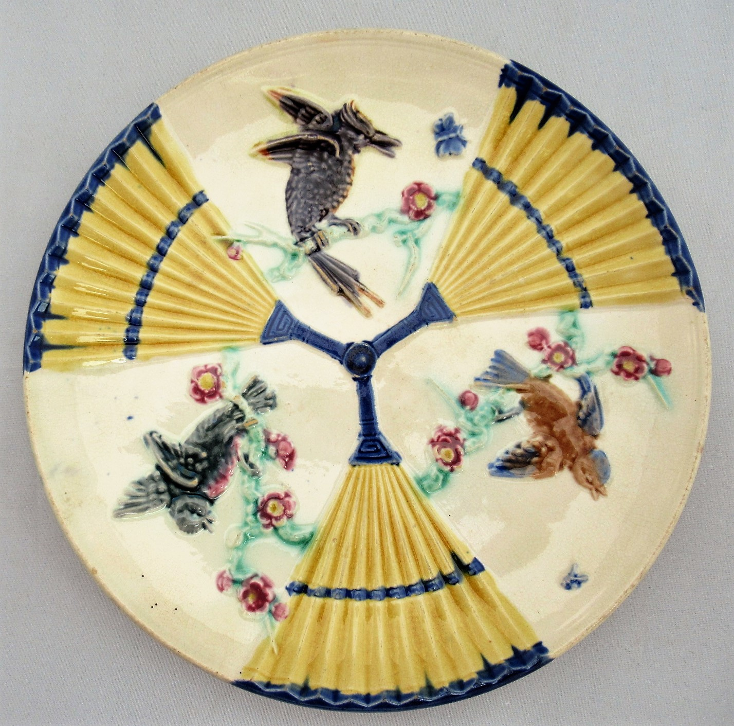 Wedgwood Aesthetic period majolica plate with fan and bird motifs, 1882