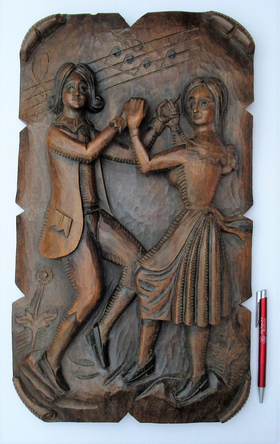 Carved early 20th century Tyrol region plaque with dancing couple
