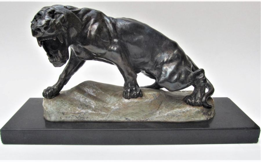 After Thomas Francois Cartier, bronzed spelter model of a snarling lioness, slate plinth, c1925