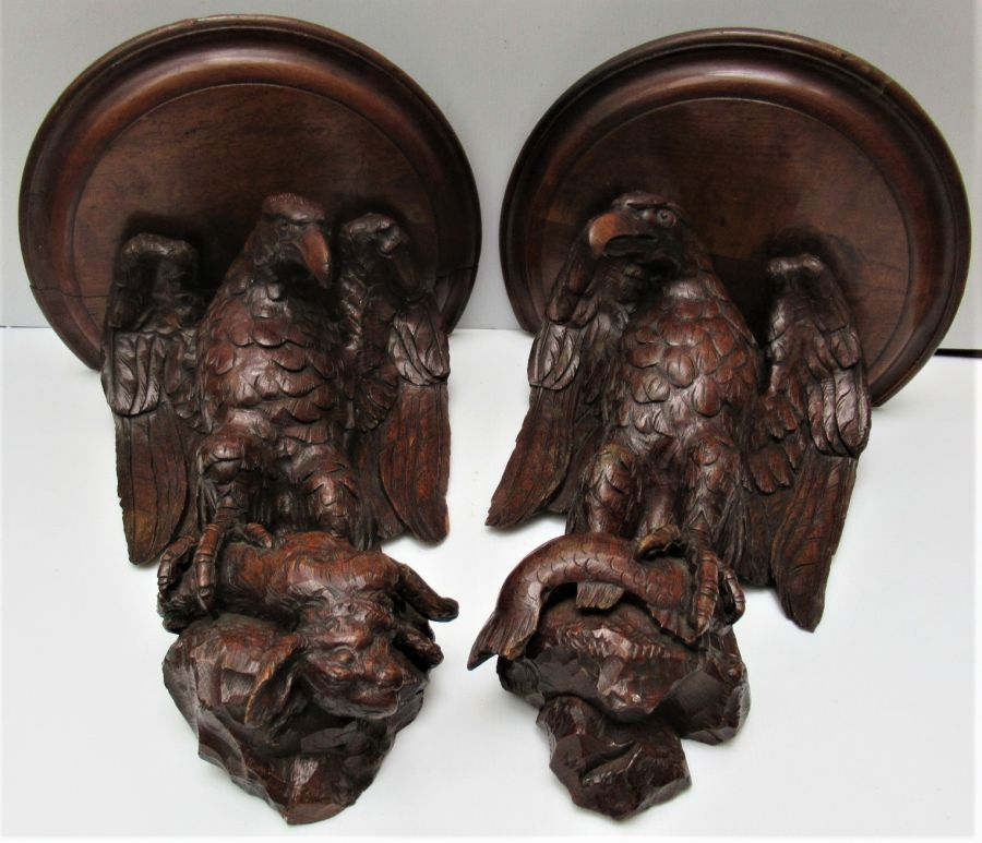 Pair of large English Oak carved eagles with prey in the form a wall brackets, c1875