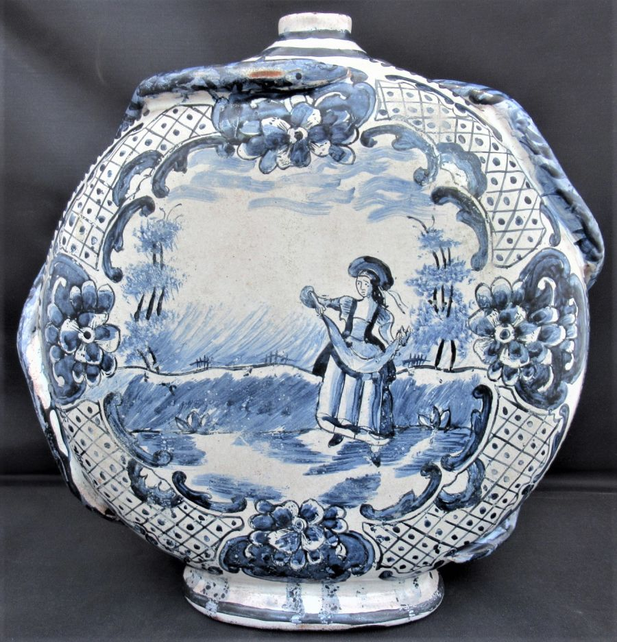Delft moon flask or bottle, c1750, blue and white with snake handles
