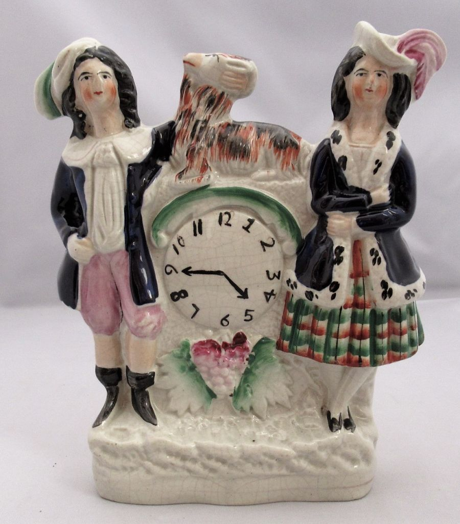 English Staffordshire flatback clock group, man and woman with goat, c1850