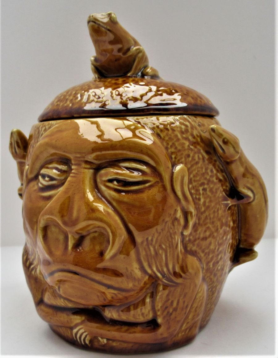 Salopian Art Pottery gorilla jar and cover modelled by J A Hartshorne, c1905