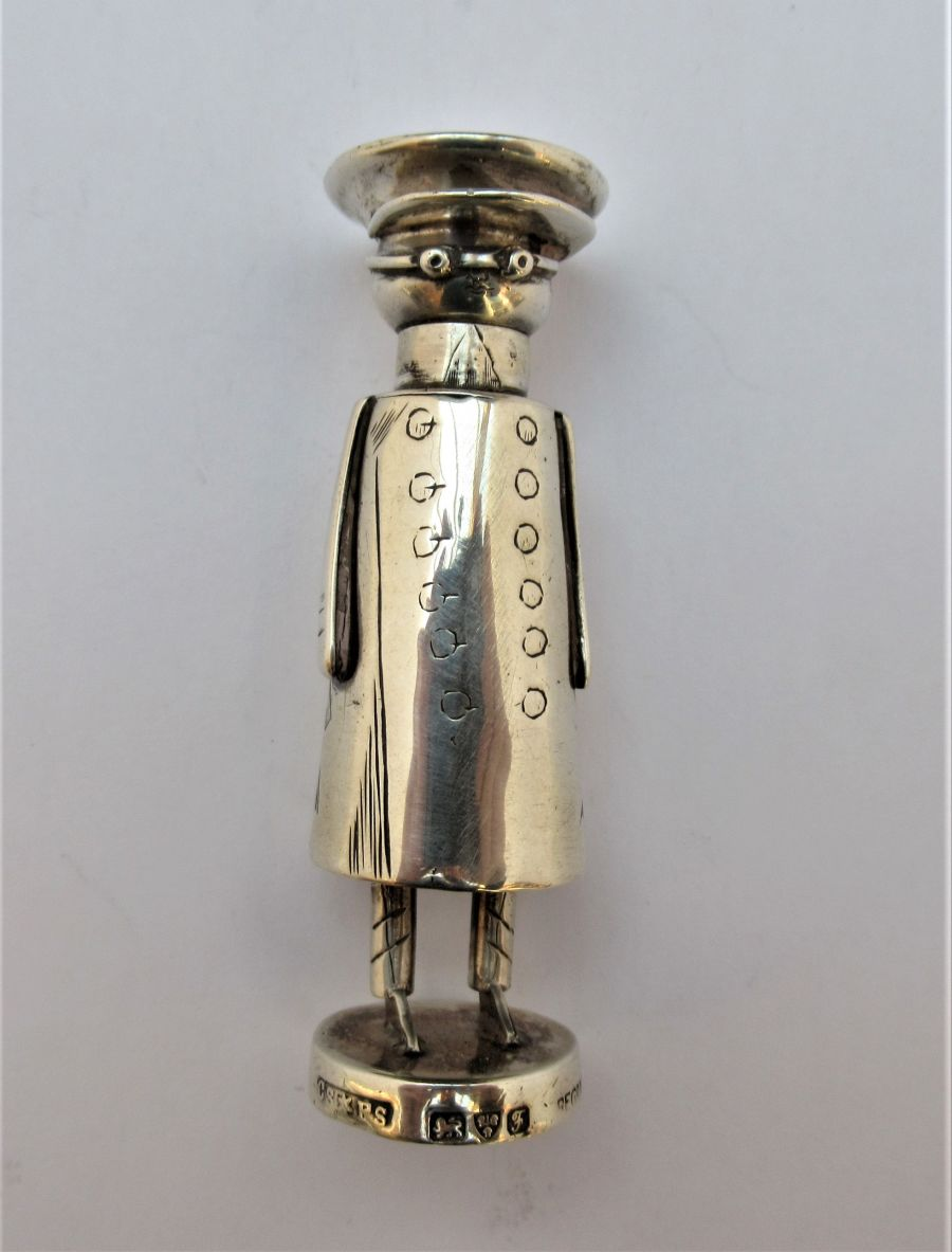 Edwardian novelty sterling silver cayenne pepper pot, chaffeur/Mr Popple, Shepherd & Saunders, Chester 1906