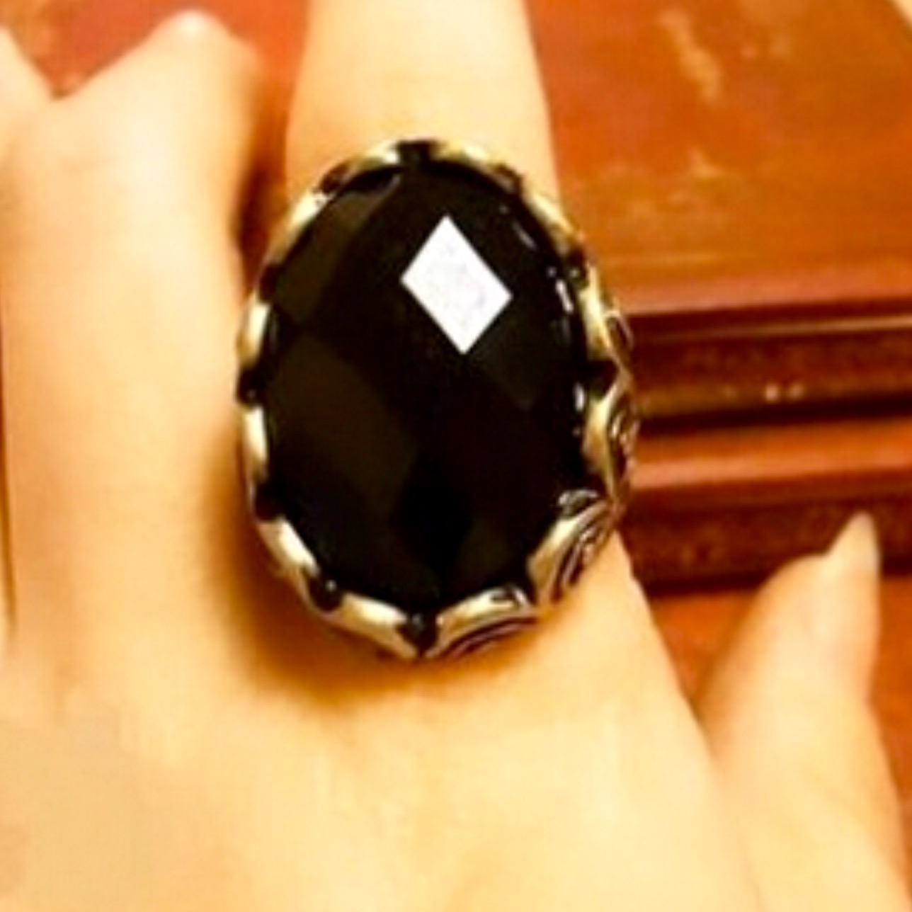 Large black oval gemstone ring