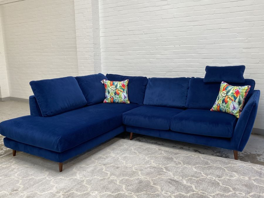 Helsinki Blue Fabric Corner Sofa with Head Rest and dressing it with luxurious velvet fabric.