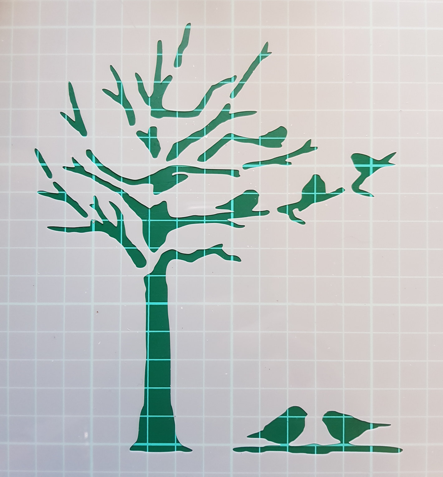 Birds and tree stencil cake decorating