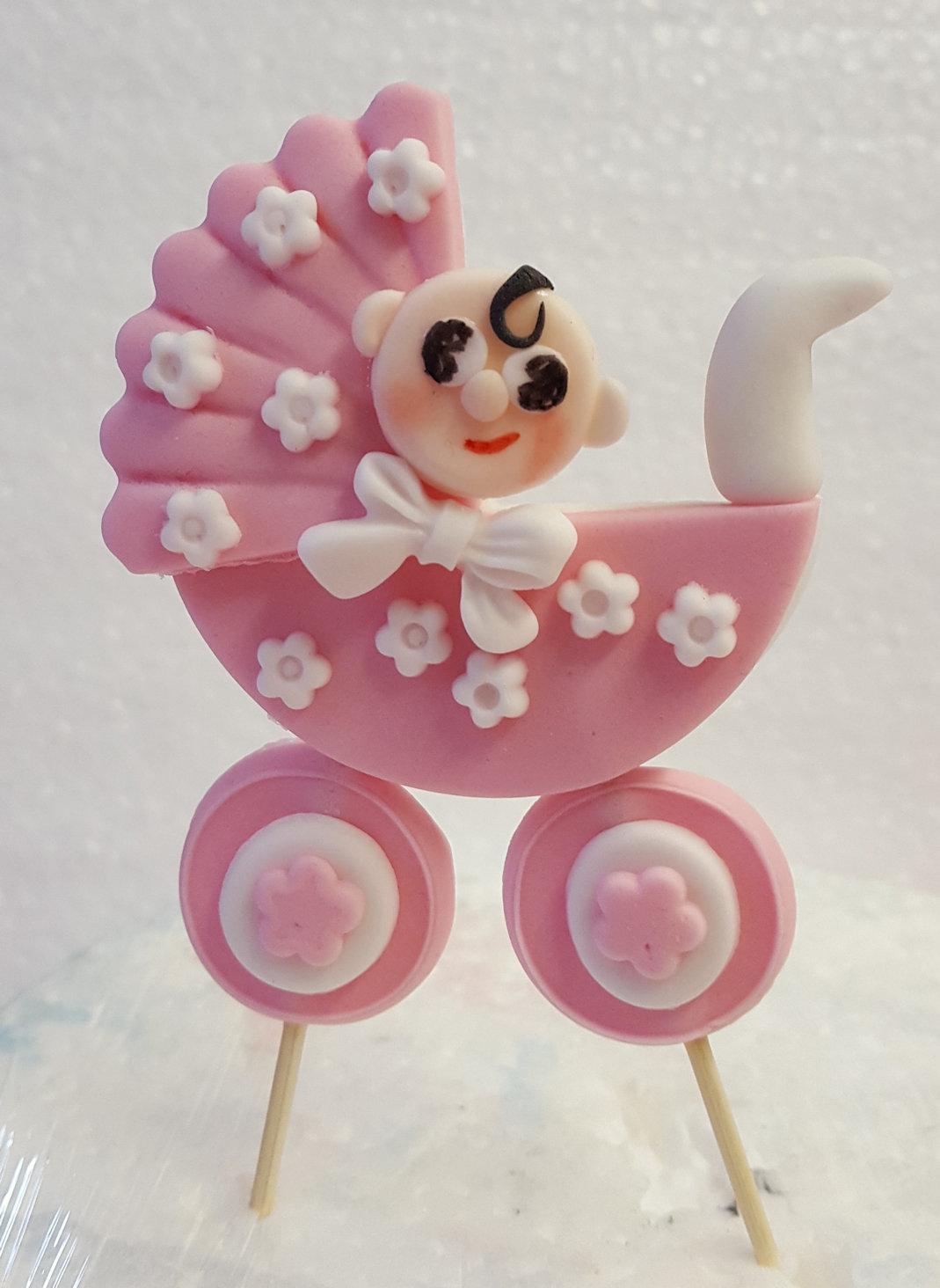 Baby in a pram cake topper