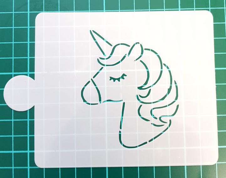 Unicorn stencil cake decorating
