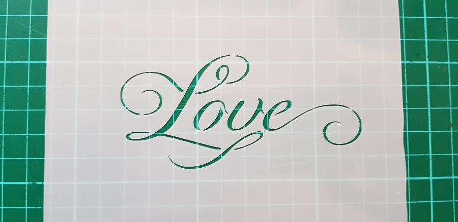 Curly Love stencil cake decorating