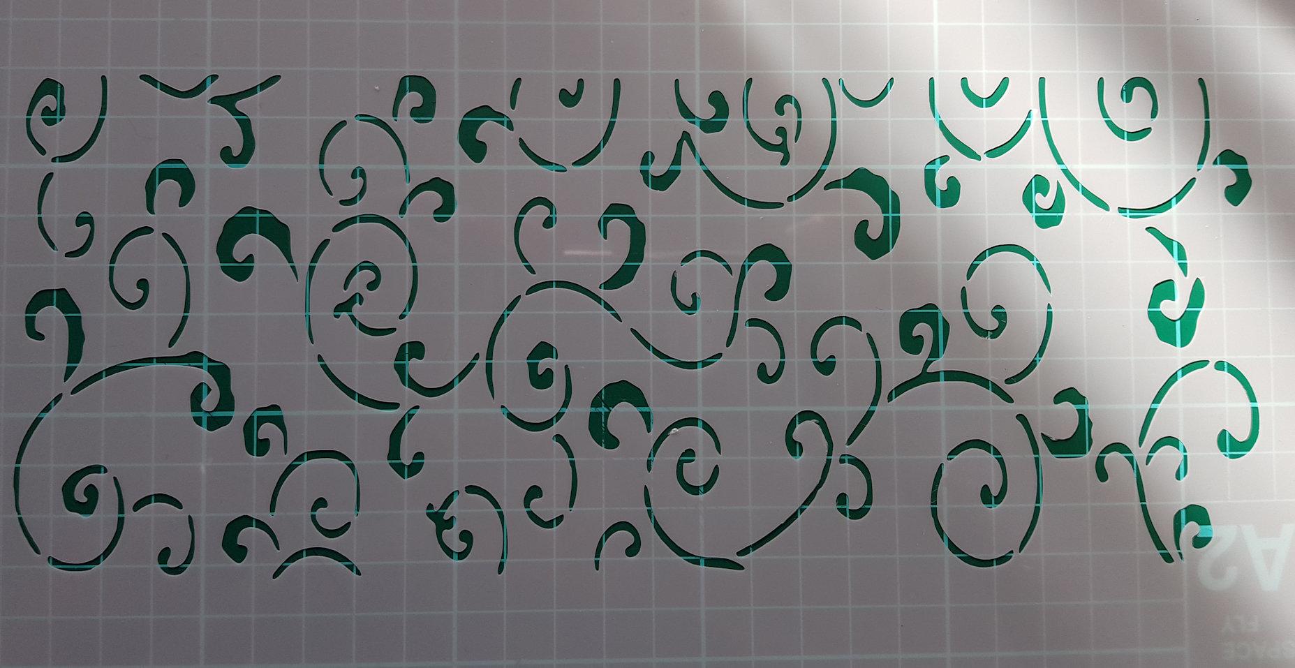 leafy swirl Stencil cake decorating
