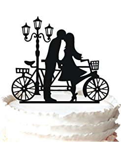 Love under the light with a bike acrylic cake topper