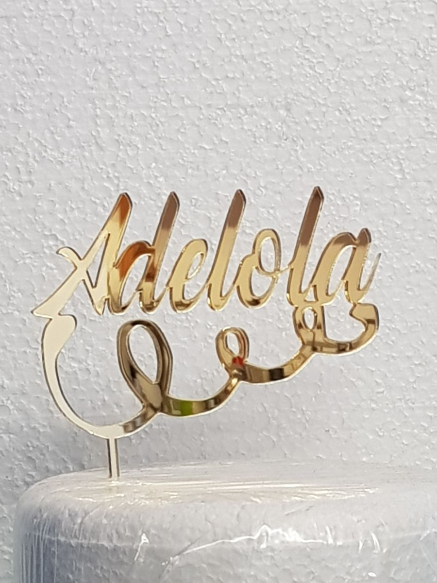 Name with curl under acrylic cake topper