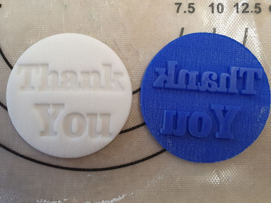Thank you block letters acrylic stamp into fondant