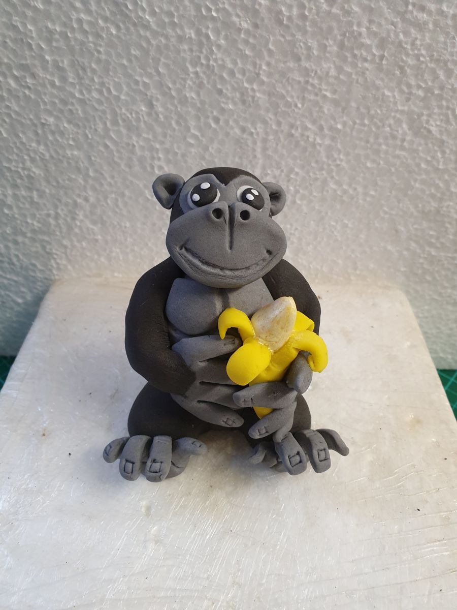 Gorilla with banana cake topper