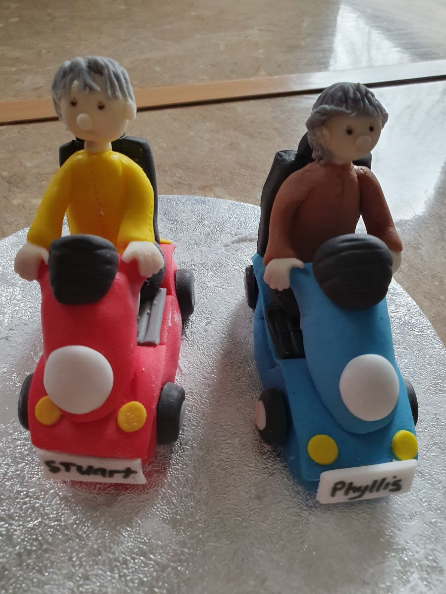 Mobility scooter with male or female hand made gumpaste