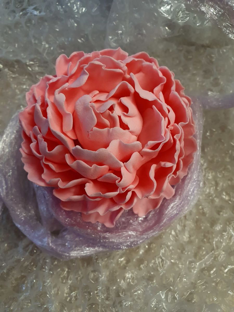 Large gumpaste rose measures about 6 inch across