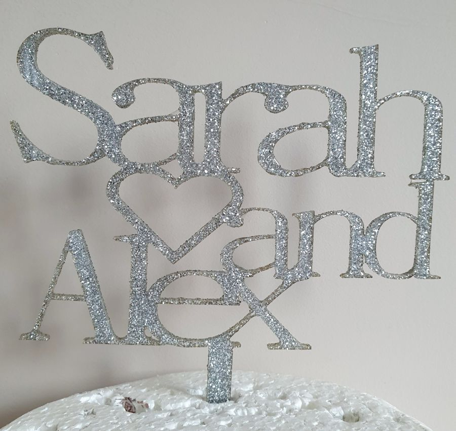 2 names with a heart acrylic cake topper