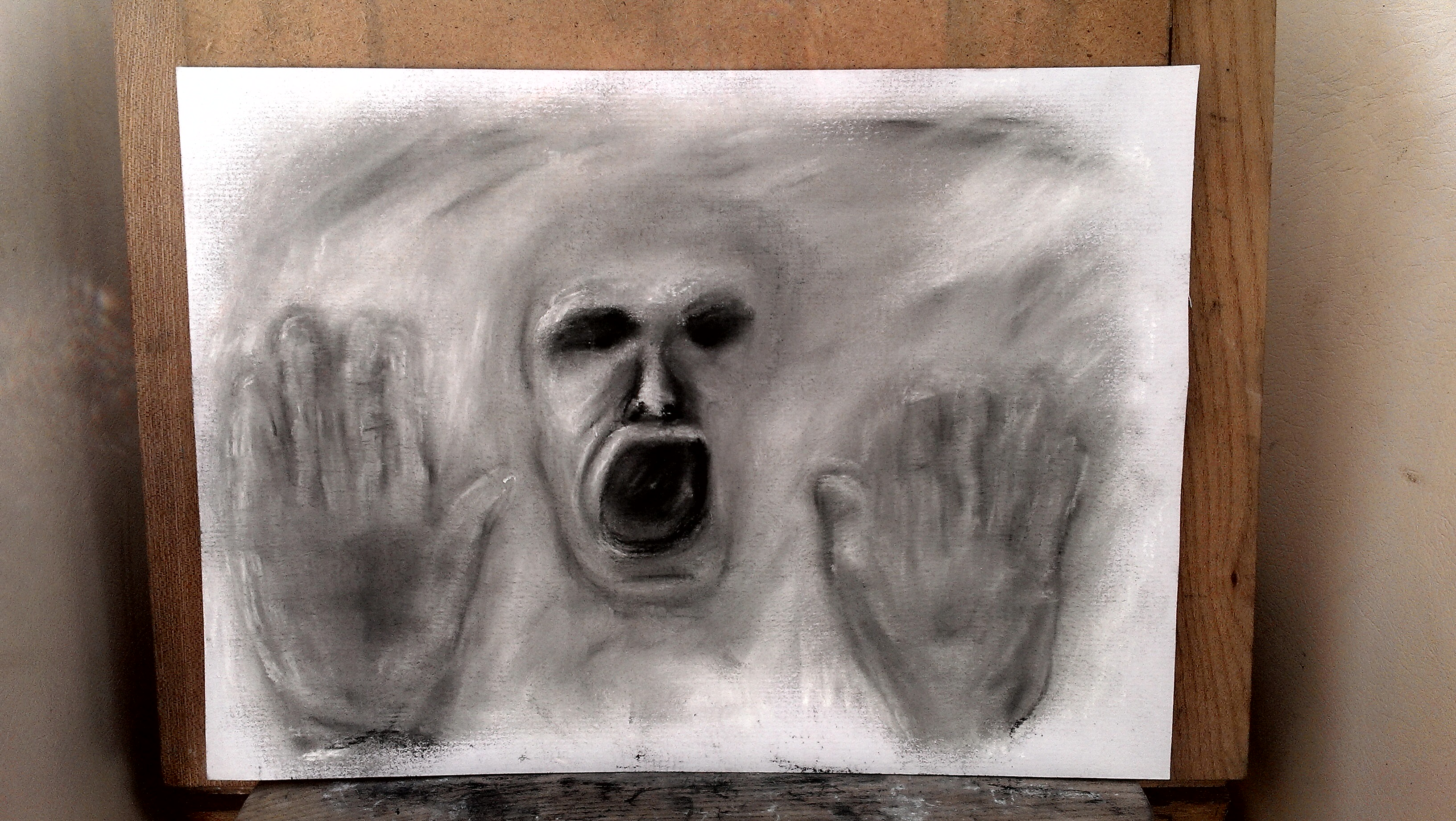 Original drawing man trying to get out of page pastels