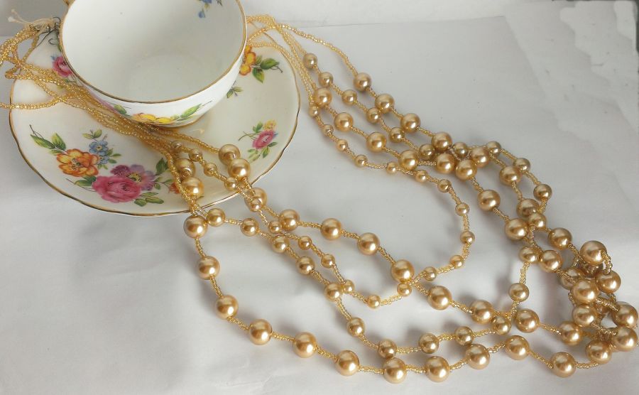 Champagne beaded 4 stringed faux pearl necklace