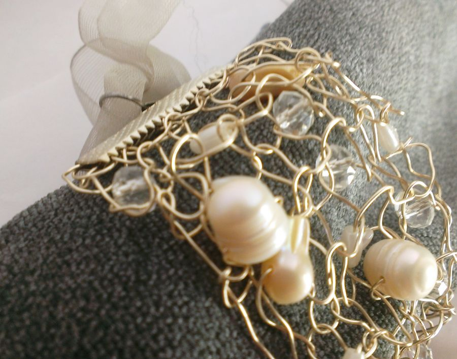 Knitted silver wire bracelet with mother of pearl freshwater pearls crystals