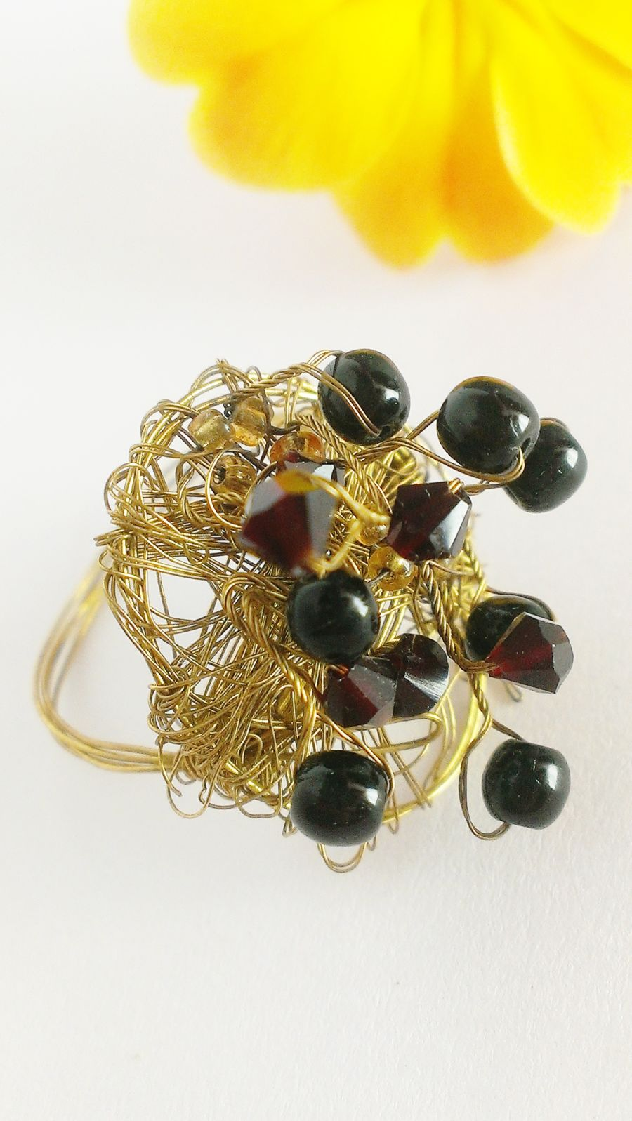 Dark red crystal with black beaded handcrafted gold wire ring size q