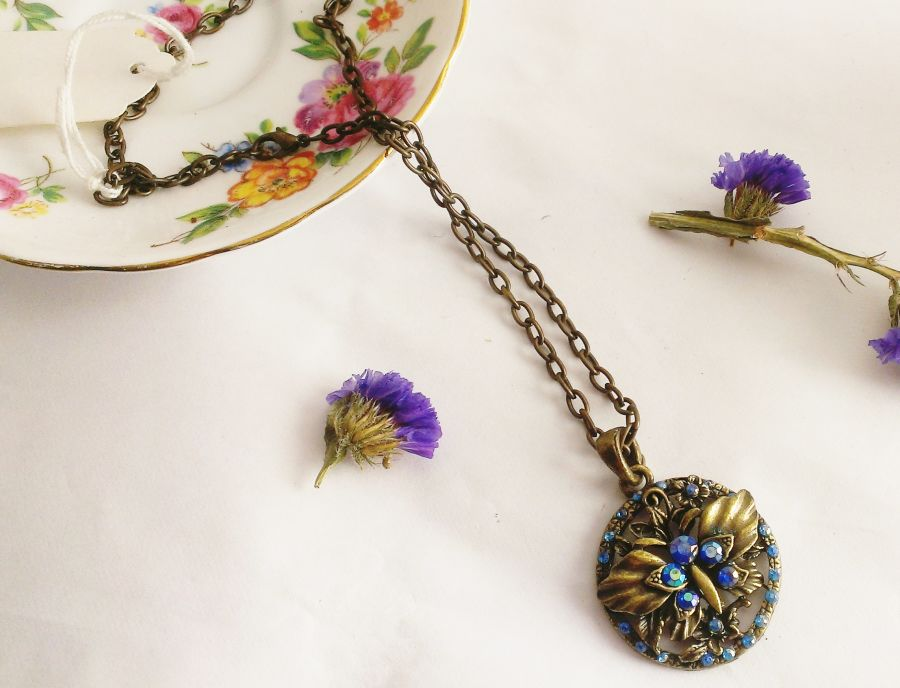 Antique Look Bronze Butterfly Blue Crystal Pendant