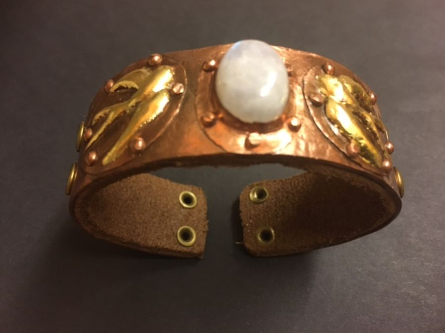 Embossed copper cuff with moonstone & swallows