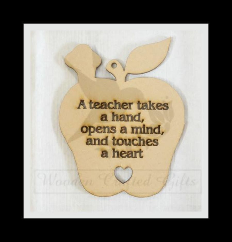 Hanging Apple - A teacher takes a hand, opens minds and touches a heart.