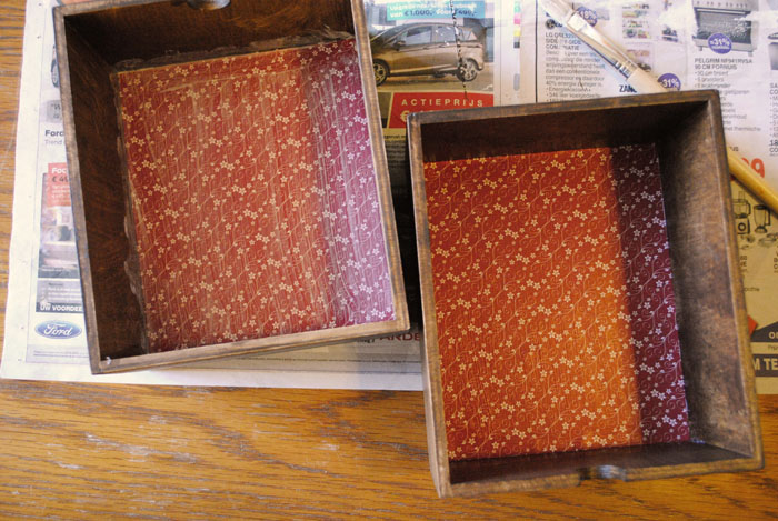 Two drawers with lining paper applied